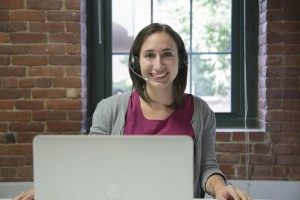 Virtual Assistant, at computer with headset